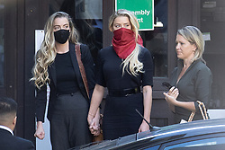 © Licensed to London News Pictures. 07/07/2020. London, UK. US actor Amber Heard (red facemask) arrives at The High Court in Central London with her sister Whitney Heard (L) and Australian lawyer Jennifer Robinson. Johnny Depp's libel trial against The Sun newspaper is due to take place over the next three weeks over allegations he was violent and abusive towards his ex-wife Amber Heard. Photo credit: Peter Macdiarmid/LNP