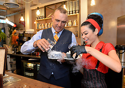 EDITORIAL USE ONLY<br /> Vinnie Jones and waiters serve customers a 'gunpowder' coffee, specially created by Bompas and Parr at the TimberYard in London's Seven Dials, which has been transformed into a 1960s New Orleans style cafe to celebrate the launch of Mafia III, a new mobster themed open world action-adventure game created by 2K UK.