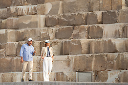 October 6, 2018 - Cairo, Egypt - U.S First Lady Melania Trump walks with her guide Dr. Ashraf Mohe El-Din, Pyramids Manager Saturday as she tours the Giza Pyramids October 6, 2018 outside Cairo, Egypt. The First Lady is on the last leg of her first overseas solo trip. Fashion critics called the First Ladies choice of outfit similar to Michael Jackson, Carmen Sandiego and Indiana Jones. (Credit Image: © Andrea Hanks via ZUMA Wire)