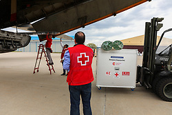 March 23, 2019 - Madrid, Spain - Operatives of the Cruz Rija carrying the humanitarian material on the plane that will depart for Mozambique. (Credit Image: © Jesus Hellin/ZUMA Wire)