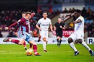 George Thomas of Scunthorpe United (18) shot is blocked by Brandon Mason of Coventry City (3) during the EFL Sky Bet League 1 match between Scunthorpe United and Coventry City at Glanford Park, Scunthorpe, England on 5 January 2019.