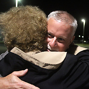 Candidate Gary Doetsch hugs Carolyn Thomas outside the Carolina Beach Recreation Center. (Jason A. Frizzelle)