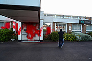 Birmingham, United Kingdom, June 14, 2021: An activist appears to be pelting red paint on an American industrial company admin office specializing in lightweight metals engineering and manufacturing known as Arconic in Bermingham on Monday, June 14, 2021.  (Photo by Vudi Xhymshiti)