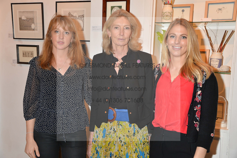 Left to right, OCTAVIA DICKINSON, JESSICA DICKINSON and PHOEBE DICKINSON at an exhibition of works by Beatrice von Preussen held at The Gallery on The Corner, 155 Battersea Park Road, London SW8 on 11th December 2013.