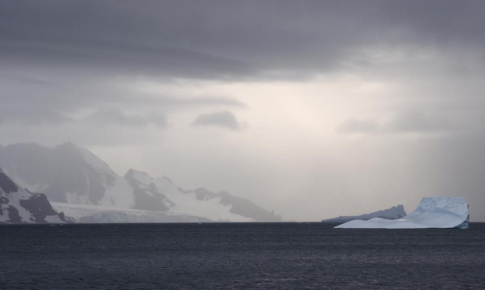 Grey sky, glaciers and icebergs.  South Shetland Islands, Antarctica.   03Mar16