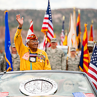 081413        Brian Leddy<br /> Teddy Draper Sr. waves to spectators during the annual Navajo Code Talkers Day parade in Window Rock.