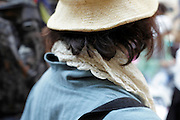 back view close up of woman with hat and scarf