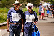 19 JUNE 2021 - DES MOINES, IOWA: Bishop M.D. EPPRIGHT and SANDRA EPPRIGHT of Faith Tabernacle Church of God in downtown Des Moines, walk through the Juneteenth celebration in Des Moines. They were wearing tee shirts with their Covid vaccination status. Juneteenth marks the day, after the Civil War, that slaves in Texas learned that they were free. Slaves in Texas were freed when Union army General Gordon Granger captured Galveston, Texas, and announced General Order No. 3 proclaiming freedom for slaves held in Texas. Juneteenth has been celebrated in the Black community for more than 100 years. On June 17, 2021, President Joe Biden signed the Juneteenth National Independence Day Act making it a federal holiday.      PHOTO BY JACK KURTZ