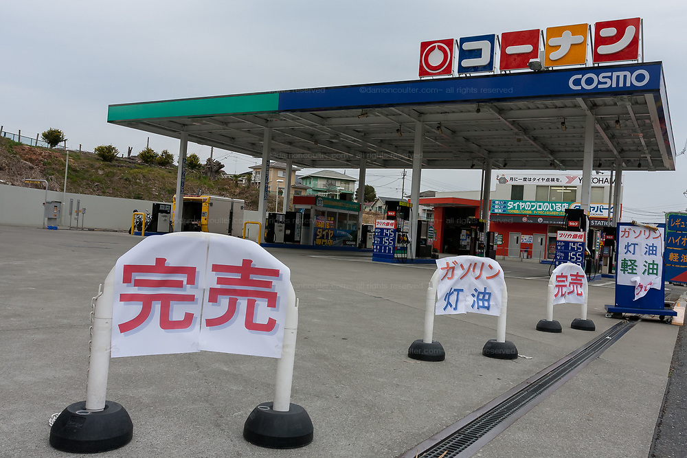 A gas station that has run out of gasoline after panic buying due to shortage fears after a magnitude 9 earthquake and large tsunami hit the Tohoku region of north east Japan  on March 11th killing nearly 20,000 people and causing massive destruction along the whole coast, and a melt-down at the Fukushima Daichi nuclear power station. Tokyo, Japan March 14th 2011