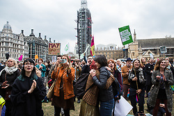 London, UK. 1st May, 2019. Climate protesters attending a Declare A Climate Emergency Now demonstration in Parliament Square celebrate the passing without a vote of a motion in the House of Commons to declare an environment and climate emergency tabled by Leader of the Opposition Jeremy Corbyn. The motion does not legally compel the Government to act.
