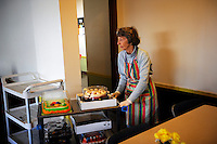 Celeste Holm arrives at the lunchroom with desserts at the First United Methodist Church in Salinas, California. Volunteers from the community drive a program that provides meals, counseling resources and occasional shelter to people in need. Basic rules, a generous spirit and a firm hand keep the program alive with minimal outside funding.