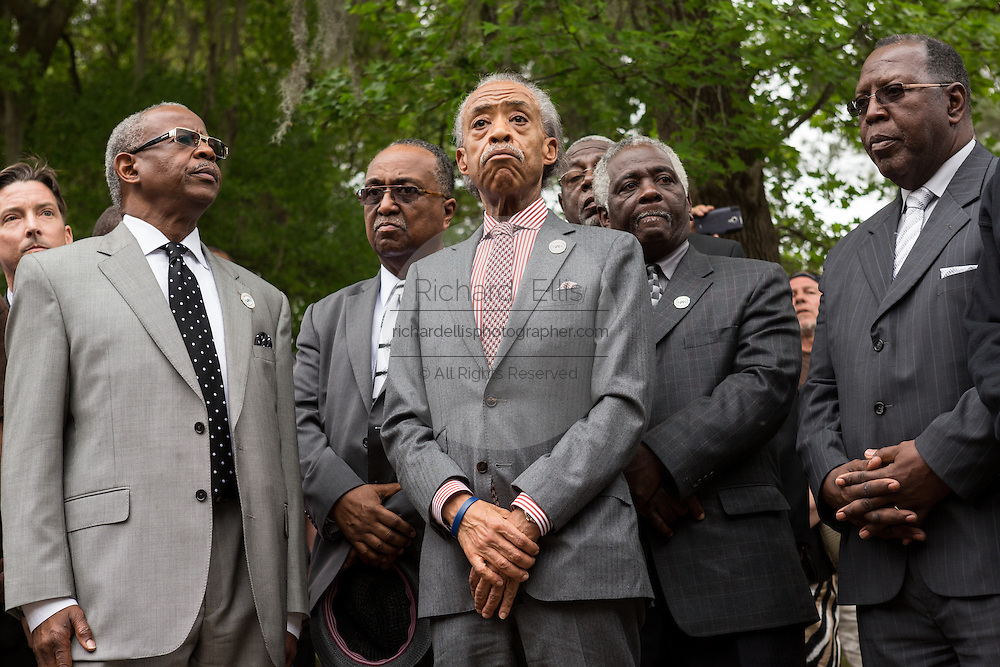 Rev. Al Sharpton stands with civil rights leaders during a peace vigil at the spot where unarmed motorist Walter Scott was gunned down by police April 12, 2015 in North Charleston, South Carolina. About 100 people showed up for the brief vigil following a healing service at Charity Mission Baptist Church.