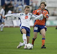 Fotball , 6. august 2006 Adeccoligaen, Haugesund - Aalesund<br />Haugesunds Kevin Nicol i kamp med Aalesunds Karl Oskar Fjørtoft<br />Foto: Jan Kåre Ness , Digitalsport