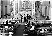 """16/09/1967<br /> 09/16/1967<br /> 16 September 1967<br /> Wedding of Mr Francis W. Moloney, 28 The Stiles Road, Clontarf and Ms Antoinette O'Carroll, """"Melrose"""", Leinster Road, Rathmines at Our Lady of Refuge Church, Rathmines, with reception in Colamore Hotel, Coliemore Road, Dalkey. Image shows a view of the altar area as the ceremony progresses."""