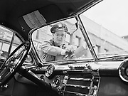 Y-480903-01.  Policeman giving ticket, in front of Police Headquarters in Old Town, SW 2nd & Oak, Portland, September 3, 1948