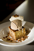 Banana bread served with coffee ice cream, vanilla whipped cream and honey pecans from Craft House in Dana Point, CA.
