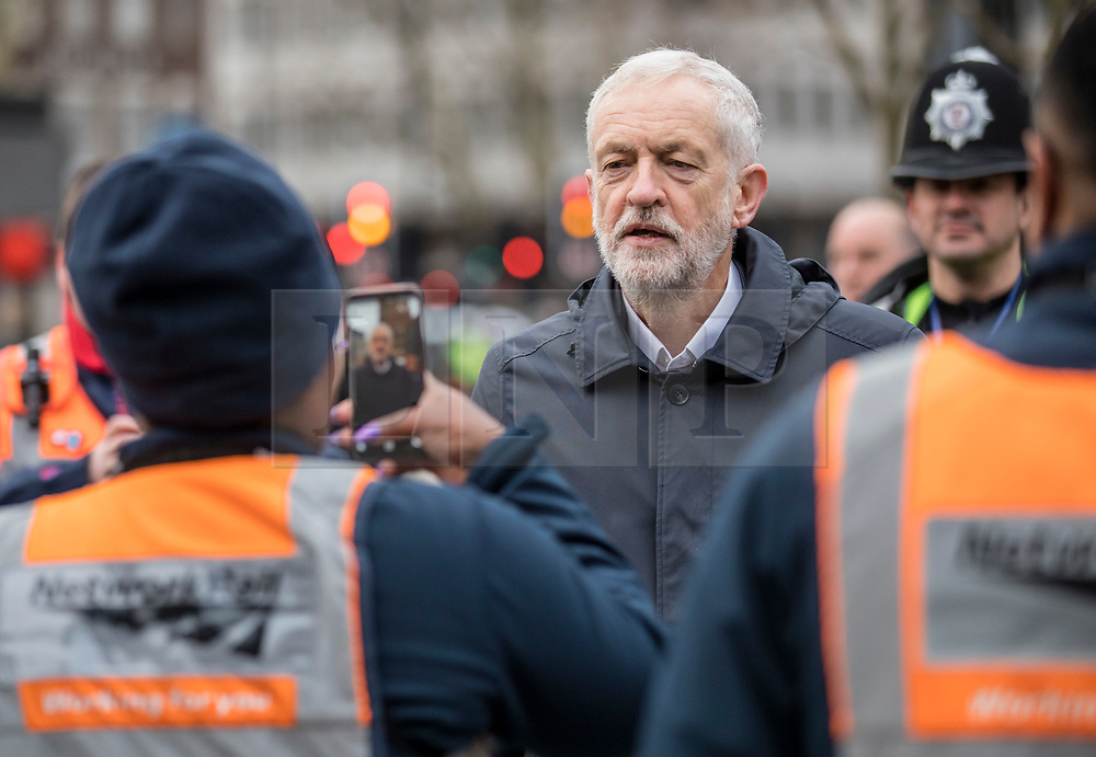 © Licensed to London News Pictures. 02/01/2019. London, UK. Leader of the Labour Party Jeremy Corbyn speaks with Network Rail staff outside King's Cross Station in London as passengers protest against 3.1% fare increases. Photo credit: Rob Pinney/LNP