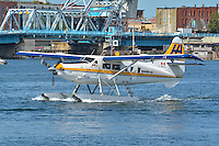 Harbour Air Single Otter taxies in Victoria Inner Harbour