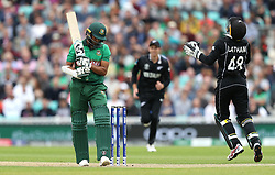 Bangladesh's Shakib Al Hasan reacts after being caught out by New Zealand's Tom Latham during the ICC Cricket World Cup group stage match at The Oval, London.