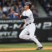 Jacoby Ellsbury, New York Yankees, running to second base as he tries to steal during the New York Yankees V Baltimore Orioles home opening day at Yankee Stadium, The Bronx, New York. 7th April 2014. Photo Tim Clayton
