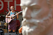 Moscow, Russia, 10/07/2004..Several thousand people attend ETNA, Russia's largest festival of ethnic and world music; this year's festival featured artists from four continents..Zulya Kamalova from Tartarstan performing amongst the statues in the Hermitage Garden.
