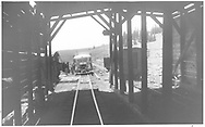 """RGS Goose #4 stopped northbound outside the Lizard Head snowshed as seen from inside the snowshed.<br /> RGS  Lizard Head, CO  Taken by Springer, Fred M. - 6/29/1951<br /> In book """"Rio Grande Southern II, The: An Ultimate Pictorial Study"""" page 276<br /> Same image as RDS059-018.<br /> Thanks to Don Bergman for additional information."""