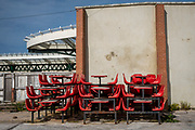 Red tables and chairs removed from the old station cafe stacked up behind a wall on Folkestone Harbour Arm on the 22nd of May 2020, Folkestone, United Kingdom. Folkestone was a major passenger ferry port to Boulogne France up until September 2000. (photo by Andrew Aitchison / In pictures via Getty Images)