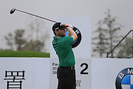 Branden Grace (RSA) tees off the 2nd tee during Saturay's Round 3 of the 2014 BMW Masters held at Lake Malaren, Shanghai, China. 1st November 2014.<br /> Picture: Eoin Clarke www.golffile.ie