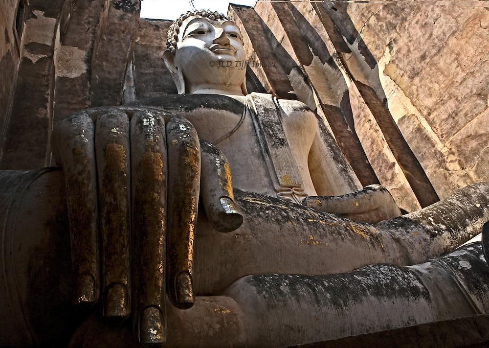 Closeup, wide angle, of seated gigantic Buddha in its enclosure at Phra Achana, Wat Sri Chum.