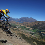 Octavio Teixeira, Christchurch, in action during the New Zealand South Island Downhill Cup Mountain Bike series held on The Remarkables face with a stunning backdrop of the Wakatipu Basin. 150 riders took part in the two day event. Queenstown, Otago, New Zealand. 9th January 2012. Photo Tim Clayton
