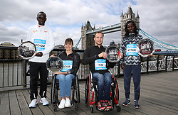 Overall winners of the men and women's Abbott World Marathon Majors Series Kenya's Eliud Kipchoge (left) and Kenya's Mary Keitany (right) with men and women's wheelchair winners Switzerland's Marcel Hug (second right) and Manuela Schar (second left) during a photocall for the 2018 Virgin Money London Marathon. PRESS ASSOCIATION Photo. Picture date: Monday April 23, 2018. See PA story ATHLETICS London. Photo credit should read: John Walton/PA Wire