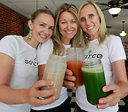 The three co-owners of the Source Juicery are (from left) Lisa Hudson, Chrissy Stevens, and Michelle Motley, shown making a toast to the success of their downtown Edwardsville business.