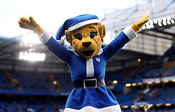 Chelsea mascot Bridget the Lioness wearing a santa claus outfit during the Premier League match at Stamford Bridge, London.
