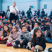 Students assemble prior to a ribbon cutting ceremony in the new gymnasium at Eastwood Elementary School in Hillsboro, Ore., on Tuesday, Feb. 4, 2020.