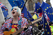 Anti Brexit pro Europe demonstrator sings a pro European song in Westminster opposite Parliament on the day MPs vote on EU withdrawal deal amendments on 29th January 2019 in London, England, United Kingdom.