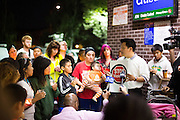 Locals gather outside the N. Milpitas Blvd 7-Eleven on Sept. 14, 2012 during a candle lit vigil in memory of Mohammad Reza Sadeghzadeh, a 67-year-old 7-Eleven night clerk who was murdered on Sept. 8 during a 2:13 a.m. robbery.  Photo by Stan Olszewski/SOSKIphoto.