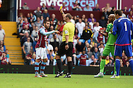 Aston Villa 's Carles Gil (l) reacts after he is booked by referee Robert Madley for diving having been fouled in the penalty area by Younes Kaboul of Sunderland .Barclays Premier League match, Aston Villa v Sunderland at Villa Park in Birmingham, Midlands on Saturday 29th August  2015.<br /> pic by Andrew Orchard, Andrew Orchard sports photography.