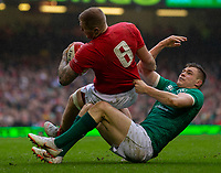 Wales' Ross Moriarty is tackled by Ireland's Garry Ringrose<br /> <br /> Photographer Bob Bradford/CameraSport<br /> <br /> Guinness Six Nations Championship - Wales v Ireland - Saturday 16th March 2019 - Principality Stadium - Cardiff<br /> <br /> World Copyright © 2019 CameraSport. All rights reserved. 43 Linden Ave. Countesthorpe. Leicester. England. LE8 5PG - Tel: +44 (0) 116 277 4147 - admin@camerasport.com - www.camerasport.com