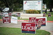 Campaign signs outside a polling location in Plano, Texas on November 8, 2016. Collin County has seen unusually high voter turnouts this election cycle. (Cooper Neill for The Texas Tribune)
