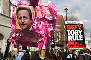 A David Cameron pig shaped pinata during a demonstration outside Downing Street as protesters gather to protest against David Cameron's links to offshore finances on April 9th, 2016 in London, United Kingdom. Thousands of protesters gathered calling for the Prime Minister to resign and to protest over his recently revealed tax dealings in the Panama Papers.