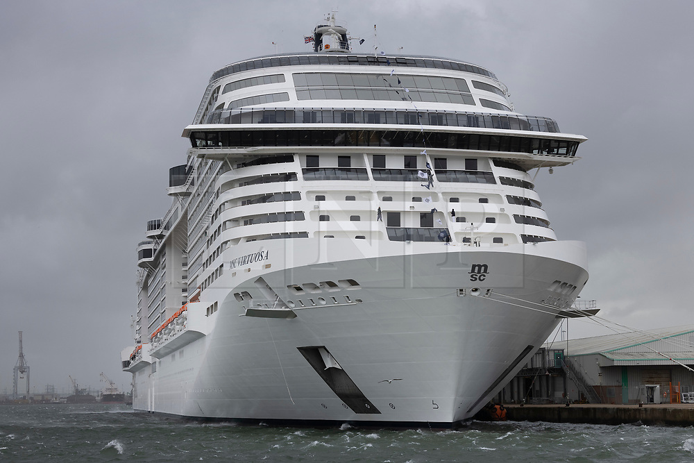 © Licensed to London News Pictures. 20/05/2021. Southampton, UK. The cruise ship MSC Virtuosa prepares for departure under a grey sky and choppy seas from Southampton on her maiden season. After a 14-month hiatus when all cruise ships stopped taking passengers due to the pandemic holiday makers are once again able to book trips. Cruise liners will only be able to operate with up to 1,000 people or 50% capacity however to comply with government Covid-19 regulations. Photo credit: Peter Macdiarmid/LNP