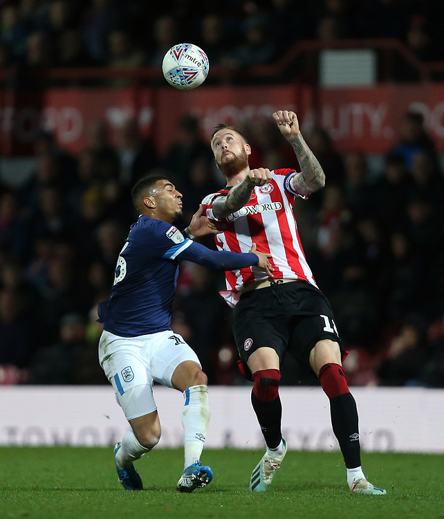 Brentford's Pontus Jansson and Huddersfield Town's Karlan Grant<br /> <br /> Photographer Rob Newell/CameraSport<br /> <br /> The EFL Sky Bet Championship - Brentford v Huddersfield Town - Saturday 2nd November 2019 - Griffin Park - Brentford<br /> <br /> World Copyright © 2019 CameraSport. All rights reserved. 43 Linden Ave. Countesthorpe. Leicester. England. LE8 5PG - Tel: +44 (0) 116 277 4147 - admin@camerasport.com - www.camerasport.com