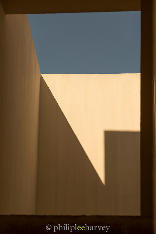 Wall casting shadow on building exterior, Cadiz, Andalusia, Spain
