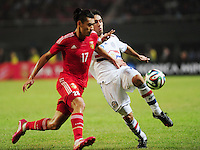 Zhang Chengdong of China, left, challenges David Mendoza of Paraguay during a friendly football match in Changsha city, central China's Hunan province, 14 October 2014.<br /> <br /> Paraguay's dismal run of form continued as they suffered a 2-1 friendly defeat to China on Tuesday (14 October 2014). The South American nation, who came into the game having won two of their previous 13 fixtures, fell short in their bid to pull off a late comeback at Changsha's Helong Stadium. In contrast to their opponents, China have now lost just two of their last 16 matches as they continue to build towards next year's AFC Asian Cup in Australia.