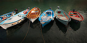 Wide view photo of fishing boats in the harbor in Vernazza on the Cinque Terre, Italy