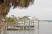 Docks and boats on Clearwater Harbor of the Gulf Intercoastal Waterway.  Indian Rocks Beach Tampa Bay Area Florida USA