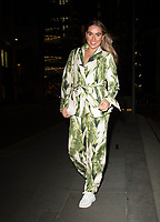 Chloe Ross outside the Gherkin in London just before heading to top of the Gherkin for dinner photo by Terry Scott