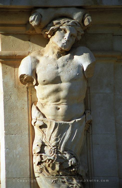 A sculpture on the chateau, torso with grapes and no arms, Chateau de l'Engarran, Laverune, Coteaux du Languedoc St George d'Orques, Languedoc-Roussillon, France