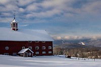 Farm in Waitsfield, Vermont during winter with Sugarbush ski resort in the background
