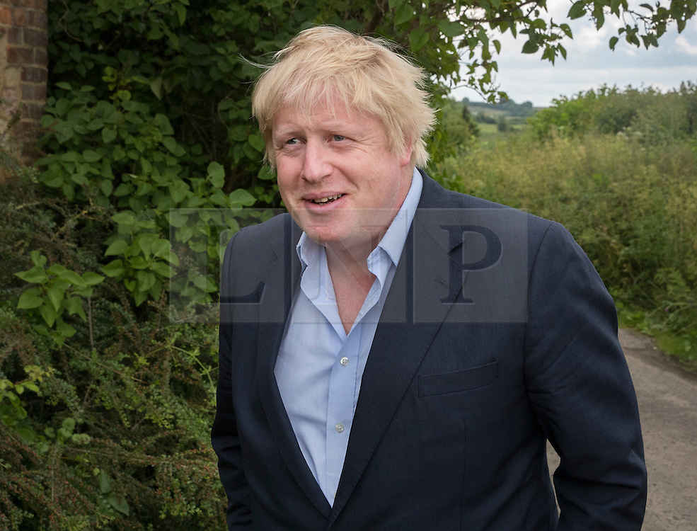 © Licensed to London News Pictures. 26/06/2016. Oxfordshire, UK. Boris Johnson walks near his home in Oxfordshire, where today he his meeting with MPs. Prime Minister David Cameron his holding a cabinet meeting tomorrow after announcing his resignation on Friday. The United Kingdom has voted to leave the EU in an historic referendum.  Photo credit: Peter Macdiarmid/LNP
